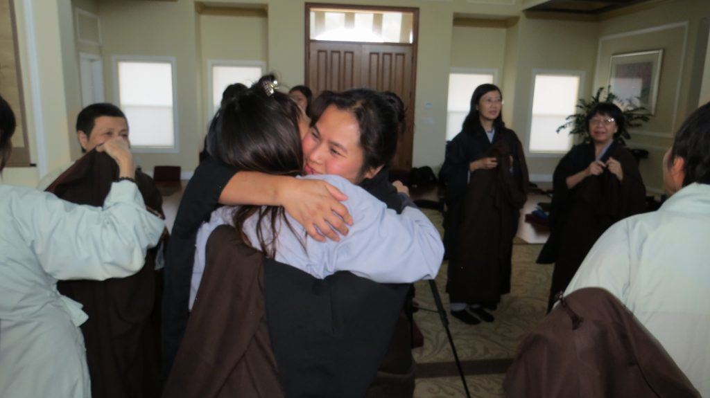 Excited; cultivators hugging; after wrapping up Seclusion Retreat; buddha hall; study hall; Sage Farm Retreat Center